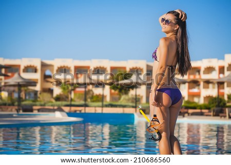 Young woman with wet skin and with a mask  going to snorkeling - stock photo