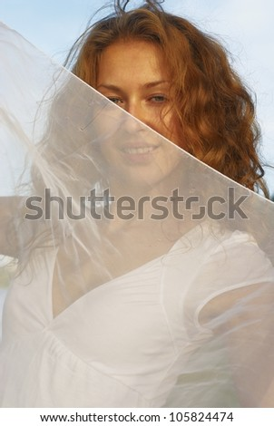 Young woman with white scarf - stock photo