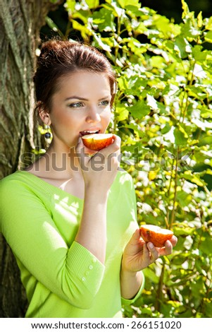 Young woman with with apple, healthy food concept, skin care and beauty, vitamins and minerals - stock photo