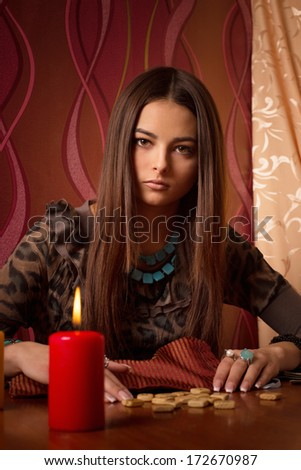 Young woman with wooden runes