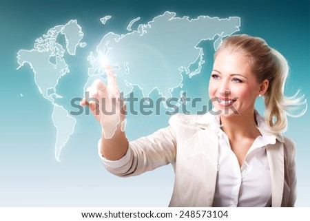 young woman with world map as a touch screen interface - stock photo