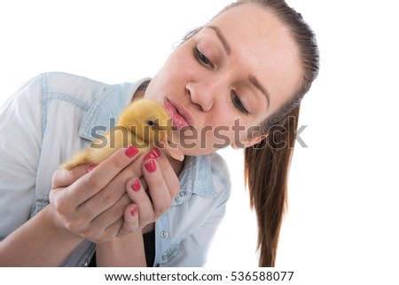 young woman with yellow duck on a white background
