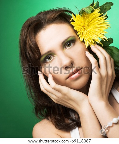 Young woman with yellow flower in her hair