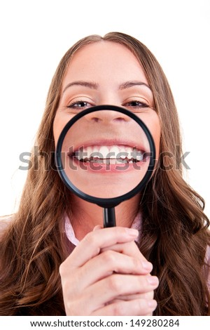 Young woman with yellow sticky note on forehead - stock photo