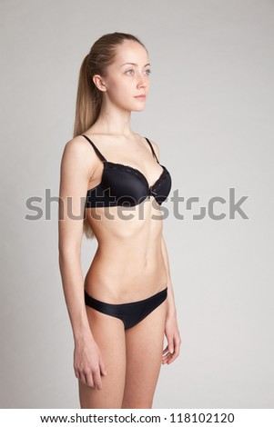 Young woman  without make-up. Natural image without retouching . Shallow depth of field. - stock photo