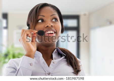 Young woman working as an helpdesk - stock photo