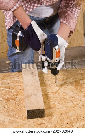 young woman working as wood builder