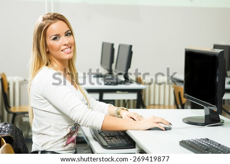 Young woman working on a computer in the classroom