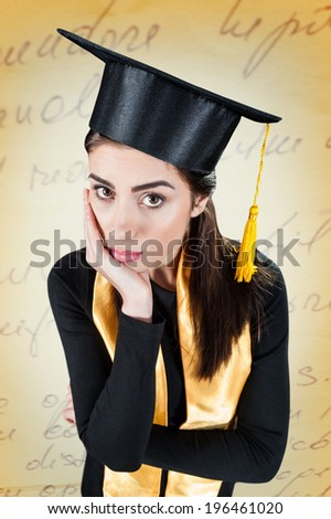 Young woman worried on her graduation day - stock photo