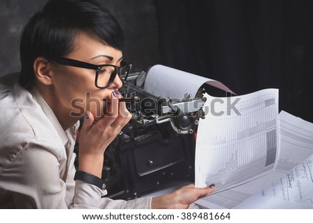 Young woman writer in creative process, retro typewriter, art space - stock photo