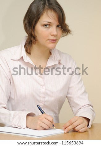 Young woman, writing - stock photo