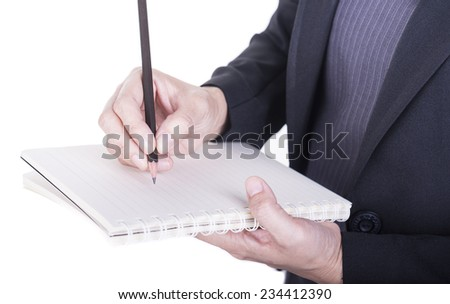 Young woman writing on note to do list at office.