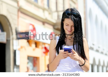 young woman writing sms on phone