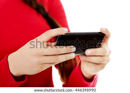 Young woman writing sms on smartphone - stock photo