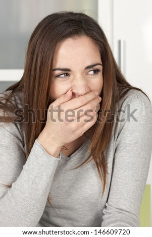 Young woman yawning at home - stock photo