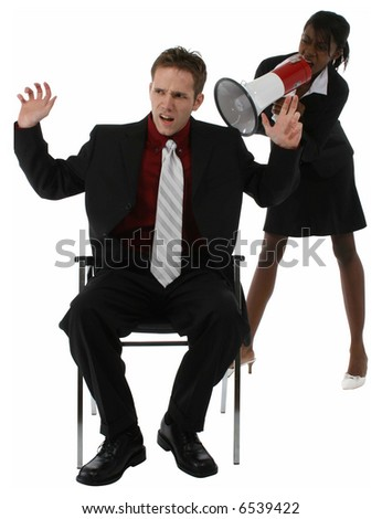 Young woman yelling at man through megaphone or bullhorn. - stock photo
