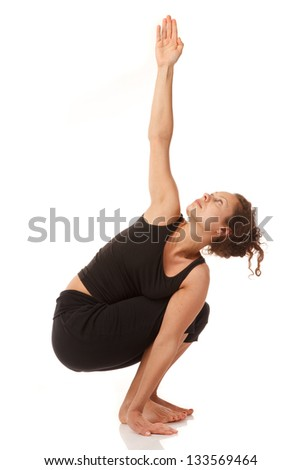 Young woman yoga instructor poses indoors,isoleted on white background - stock photo