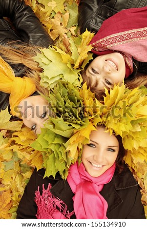 young womans wearing a wreath of autumn leaves - stock photo