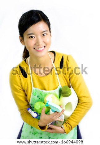 Young women and home cleaning products - stock photo