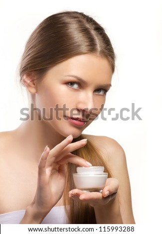 young women applying cosmetic cream isolated on wthite - stock photo