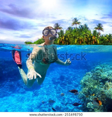 Young women at snorkeling in the tropical water - stock photo