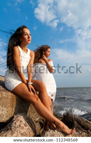 young women at the sea together