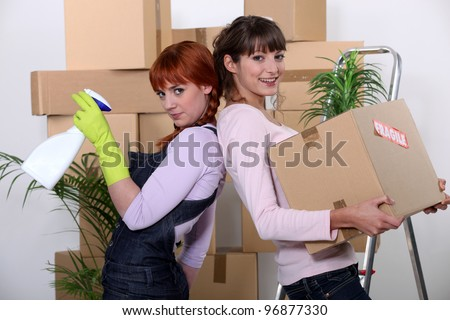 Young women cleaning out their apartment on moving day