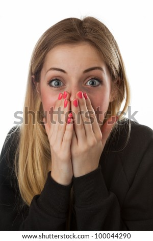 Young Women Covering Her Face in Surprise - stock photo