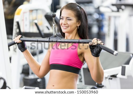 Young women do a workout at the gym and smiling