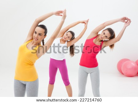 Young women doing exercise in a studio.