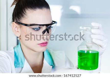 Young women doing experiment in laboratory