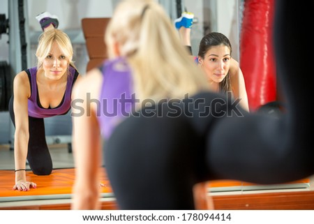 Young women doing fitness exercises - stock photo