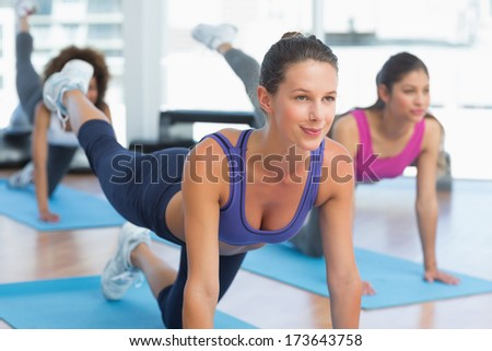 Young women doing stretching exercises in the fitness studio - stock photo