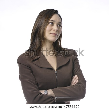 Young women has her arms crossed.She is of mixed race.Wearing a brown suit and has long brown hair.Her head is turn sideways.It is on a white background.She has a small smile. - stock photo