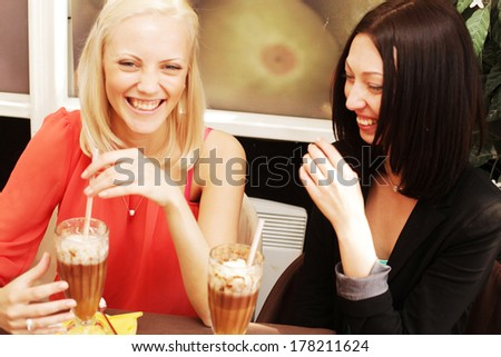 young women having coffee break together - stock photo