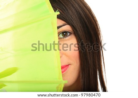 Young women holding a green umbrella isolated