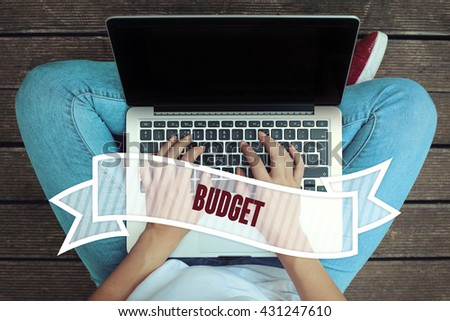 Young women holding laptop writen Budget on it - stock photo