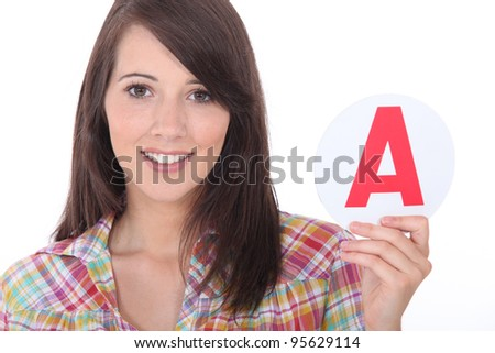 Young women holding learner plate - stock photo