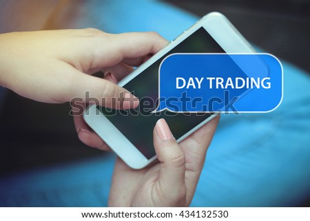 Young women holding mobile phone writen Day Trading on it - stock photo