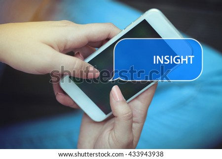 Young women holding mobile phone writen Insight on it - stock photo