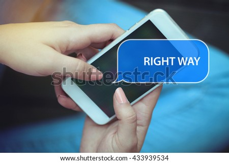 Young women holding mobile phone writen Right Way on it - stock photo