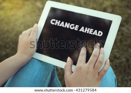 Young women holding tablet writen Change Ahead on it - stock photo