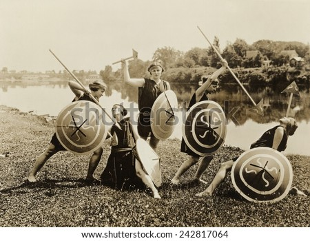 Young women in a tableau as ancient warriors perform at Seneca Falls, N.Y. seventy-fifth anniversary Equal Rights celebration on July 20, 1923. - stock photo