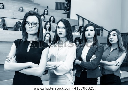 Young women in classroom with students