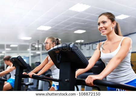 Young women in fitness club - stock photo