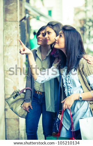 Young Women in front of a Clothing Store - stock photo
