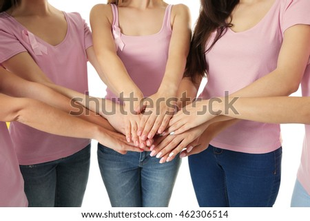Young women in pink shirts. Breast cancer concept