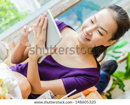 Young women in restuarant - stock photo