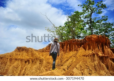 young women in rock formations place, Phae Muang Phi , cloud blue sky  - stock photo