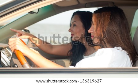 young women in the car looking
